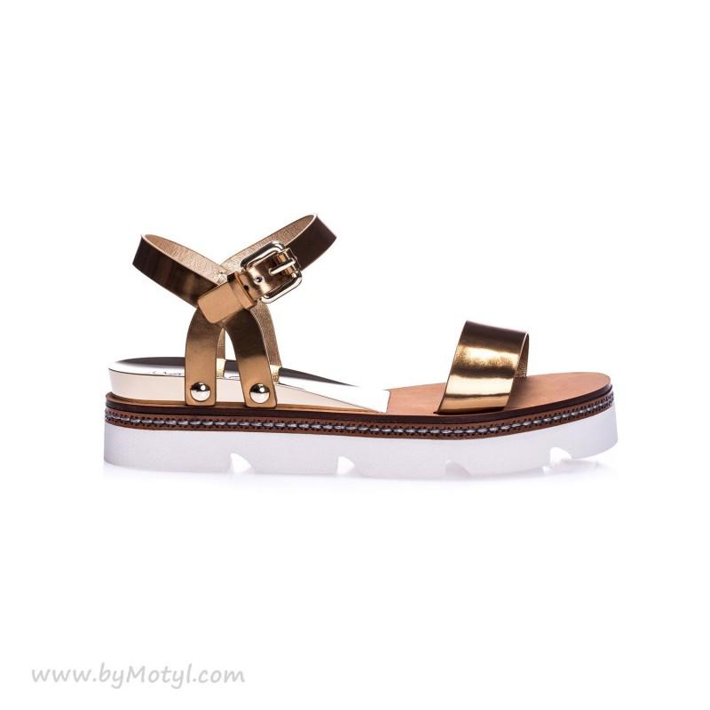 CASADEI Złote skórzane sandały na białej podeszwie